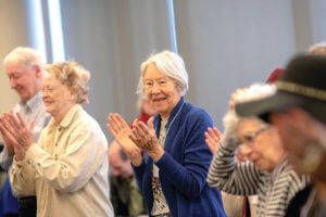 group of older people clapping